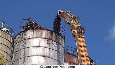 Bulldozer destroy old silo tower with ginder arm - Bulldozer...