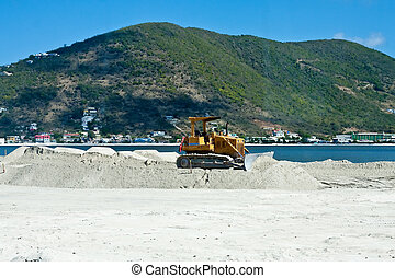 Bulldozer Grading Gravel on Tropical Beach