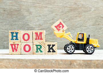 Bulldozer hold letter block E to complete word homework on wood background