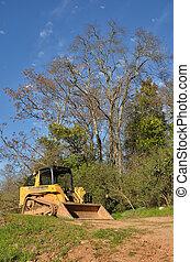 Bulldozer in a Field - A construction bulldozer in a field.