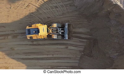 Bulldozer in action in open air quarry