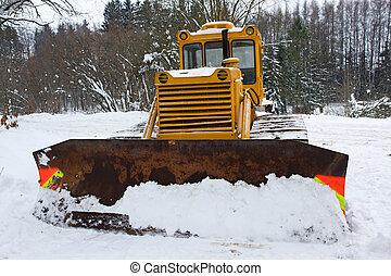 Bulldozer in the snow in winter