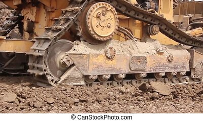 Bulldozer machine is leveling earth - Earthmover with...