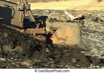 bulldozer, mise en décharge