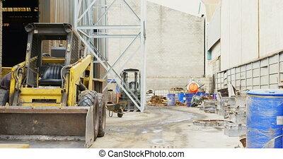 Bulldozer near foundry workshop 4k - Bulldozer near foundry ...