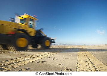 bulldozer on beach