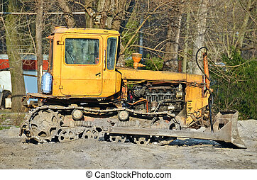 Bulldozer on road construction site - Tractor on old park ...