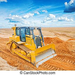 bulldozer on sand in field - bulldozer on  sand in field