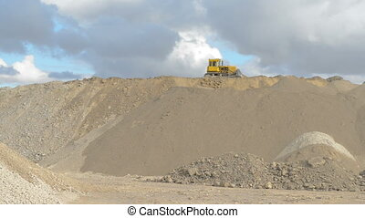 Bulldozer on the sand and clay quarry - Heavy yellow...