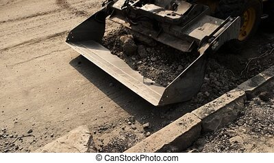 Bulldozer picking up dirt. Bucket of a loader. Repair of...