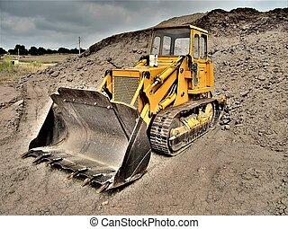 Bulldozer in dramatic landscape