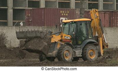 Bulldozer poured earth