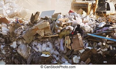 Bulldozer Pushes Rubbish at a City Dump. FullHD footage - ...