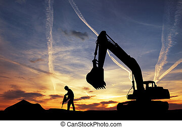Bulldozer silhouette at sunset