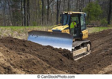 Bulldozer pushing dirt on construction site