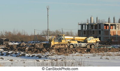Bulldozer working on construction site in summer - Building...