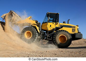 Bulldozer Working with Sand