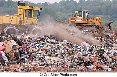 Bulldozers on a landfill site - A bulldozer moving garbage ...