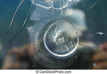 bullet hole in the window