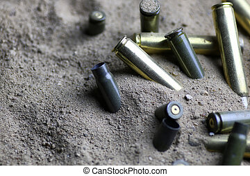 bullet in the sand - many shell casings from bullets of...