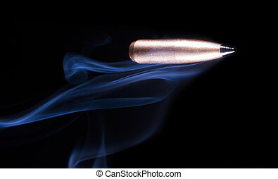 Bullet on black with smoke