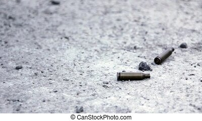 Bullet Shells Falling on the Ground in Slow Motion HD