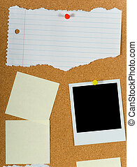 Bulletin board with assorted blank items including post-it notes a torn sheet of paper and a blank instant transfer image or polaroid