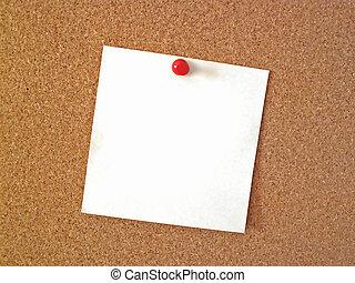 bulletin board - blank note tacked to cork bulletin board