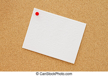 Bulletin board with a blank white greeting card