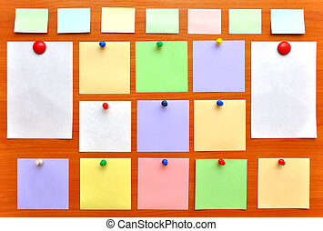 bulletin board with colorful paper notes