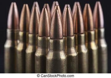 Bullets on Black - Rifle bullets close-up on black...