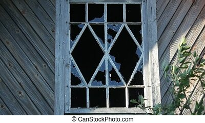 bullets pierce the pane of a wooden house outside view.