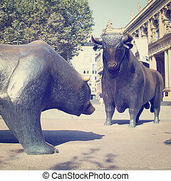 Bulls and Bears - A Bull and Bear Statues in public area.