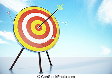 Bull's-eye concept with dart at blue sky background