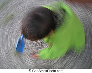 Bulls eye - Tornado child playing with motion impression