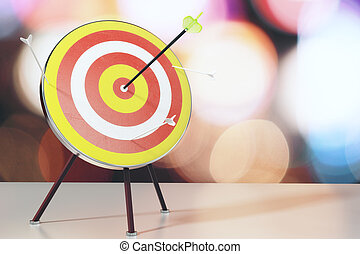 Bull's-eye with arrows on white table