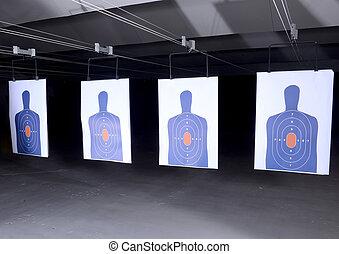 bullseye targets lined up at gun range