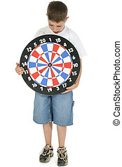 Bullseye - Young boy with dart board looking scared.