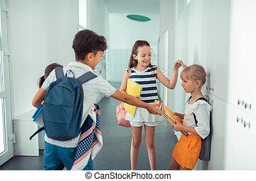 Rude children with awful behavior bullying cute blonde girl