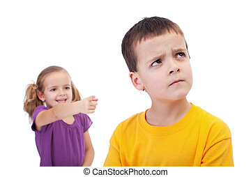 Bullying concept - girl mocking young boy - Bullying concept...