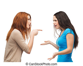 two teenagers having a fight - bullying, friendship and ...