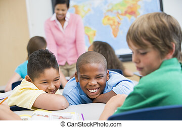 Bullying in elementary school - Boy being bullied in...