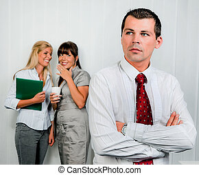 Bullying in the workplace an office. Women make fun of men