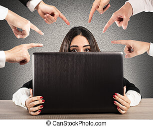 Bullying on the web - People pointing a girl hidden behind a...