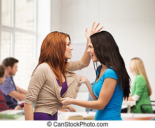 two teenagers having a fight and getting physical
