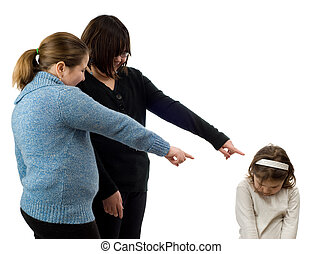 Bullying - Two older girls pointing and laughing at a young...