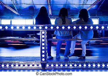 bumper cars in motion - View of a amusement park bumper cars...