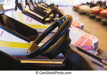 bumper cars parked in an amusement park - closeup of some...