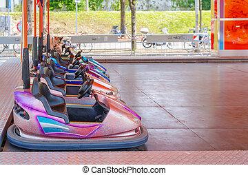 Bumper Cars - Colorful bumper cars for children in line.