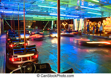 Bumper cars at night with blurred motion